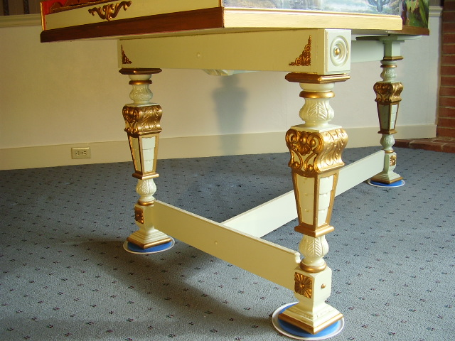 The carved antique legs of the Harpsichord.
