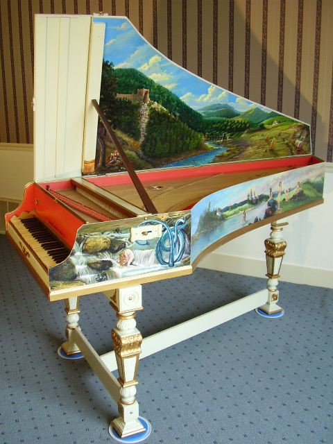 "The Flemish harpsichord- This is adorned with paintings of a ""Romanian theme""."